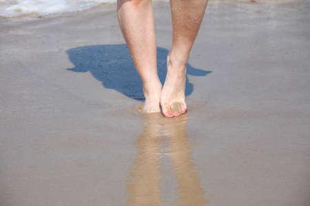 nice legs: nice legs in water, nice pedicure red nail on sandy beach