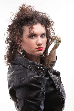 Woman with dark natural brown curly hair holding in her hands a katana sword Stock Photo - 12662256