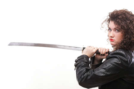 Girl - woman dark curly hair natural brown-haired holding in her hands a katana sword Stock Photo - 12661423