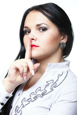 Young woman brunette girl asking for silence white isolated Stock Photo - 12755562