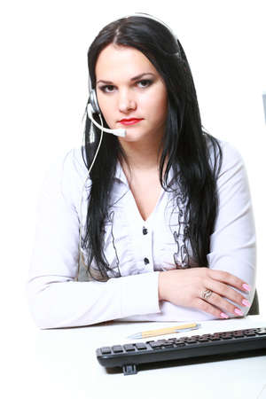 modern business woman with headset microphone sitting at office desk photo