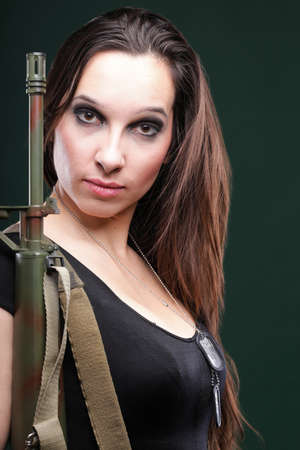 Military Army girl Holding Gun green background photo