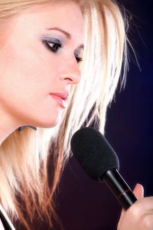 woman girl is singing rock song with a microphone photo