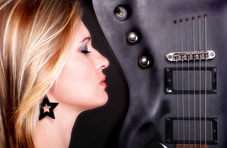 Sexy profil face girl and Guitar Woman blonde photo