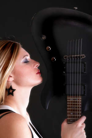 profil: Sexy profil face girl and Guitar Woman blonde Stock Photo