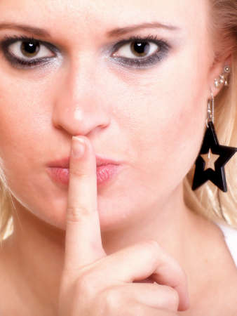 Young woman blonde girl asking for silence white isolated Stock Photo - 12830416