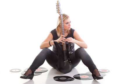 Woman with guitar listening to music - isolated over a white background analogue record photo