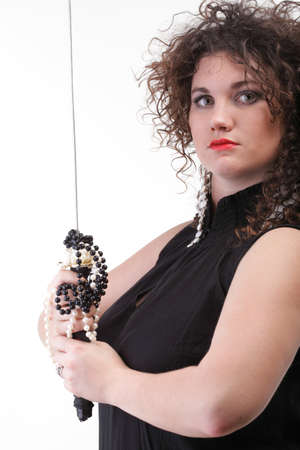 Girl - woman dark curly hair natural brown-haired holding hands katana sword Stock Photo - 12920889