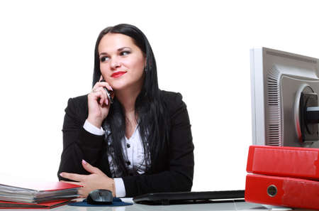 modern business woman talking phone sitting at office desk Stock Photo - 12920873