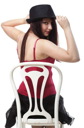 entertainment pastime girl dance in red corset chair white isolated showgirl, Stock Photo - 13326223