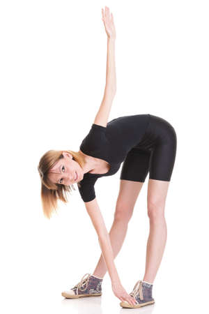 Sport Young woman in black doing exercise gymnastic pose isolated on white Stock Photo - 13006603