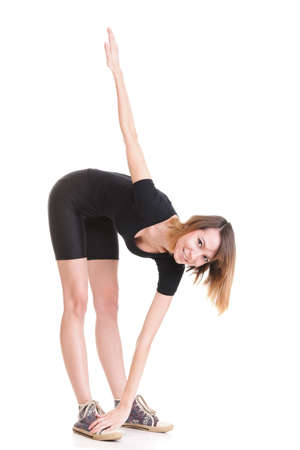 Sport Young woman in black doing exercise gymnastic pose isolated on white Stock Photo - 13006668