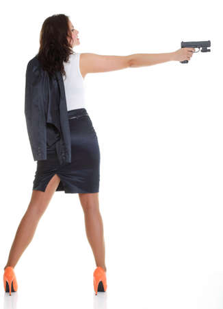 Young brunette woman with gun isolated on white full lengh Stock Photo - 13006499