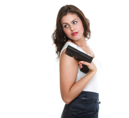 Young brunette woman with gun isolated on white Stock Photo - 13006486