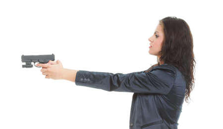 Young brunette woman with gun isolated on white Stock Photo - 13006563