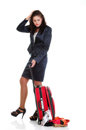 Full length of young business woman to late mishap misadventure pulling red travel bag clock isolated on white background Stock Photo - 13006533