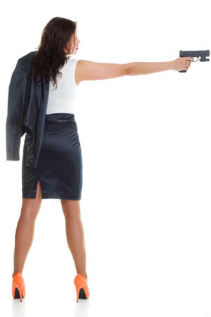 Young brunette woman with gun isolated on white full lengh Stock Photo - 13006571