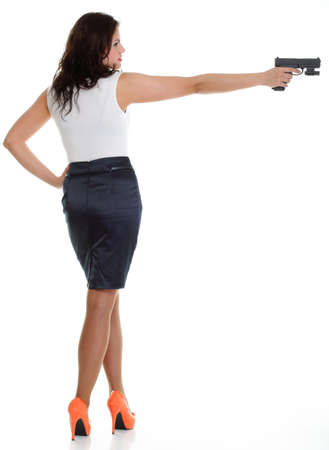 Young brunette woman with gun isolated on white full lengh Stock Photo - 13006558