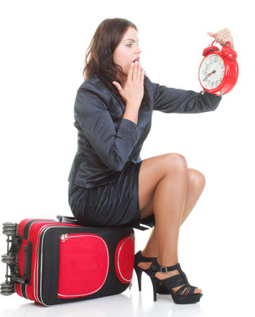 Full length of young business woman to late pulling red travel bag clock isolated on white background Stock Photo - 13030504