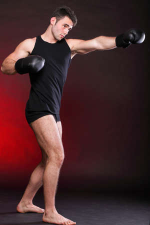 Boxer raising his arms strong athletic muscle man, sports guy showing his muscles male back isolated on black background Stock Photo - 13031265