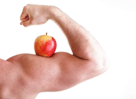 Red Apple on Mans Bicep Muscle isolated on white Stock Photo