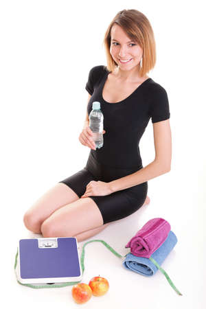 Caucasian young woman weight scale isolated over white background