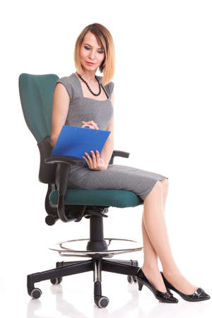 young business woman sitting with her clipboard isolated on white background Stock Photo - 13088907