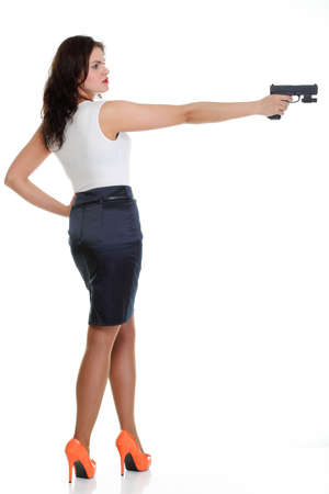 Young brunette woman with gun isolated on white full lengh photo