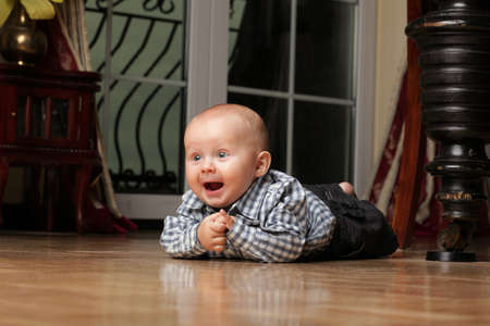 portrait of 6 months boy, male child sitting on floor Stock Photo - 13151038