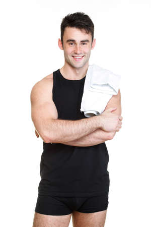 Healthy young man with towel isolated on white background photo