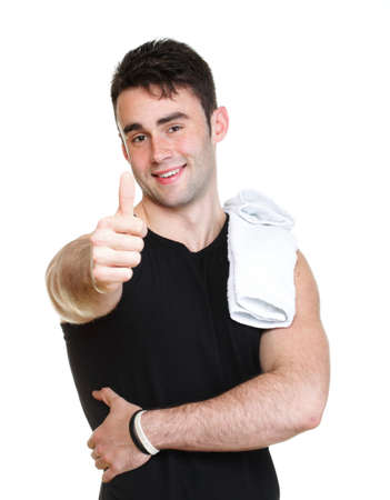 Healthy happy young man thumb up with towel isolated on white background photo