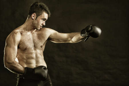 Portrait sportsman boxer in studio against dark background Stock Photo - 13151764