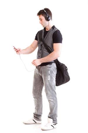 Full length portrait school boy phone headphone music isolated on white Stock Photo - 13151358