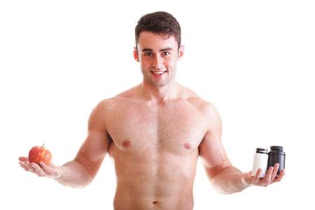 Natürlichen Apfel Vitamin oder Pille Drag tablet Man isoliert Angebot Pille in ein und Pillen in der Flasche - in der anderen Hand. Kopieren Sie Platz Boxen mit Ergänzungen Standard-Bild - 13151259