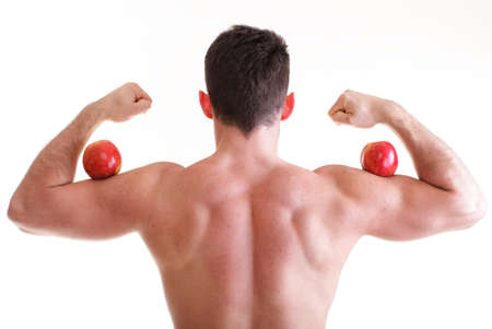 Red Apple on Man Bicep Muscle isolated on white. Athletic sexy male body builder holding photo