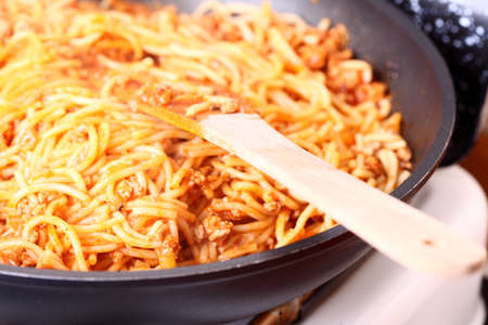 Boiling Spaghetti, frying pan, Pasta in a skillet photo