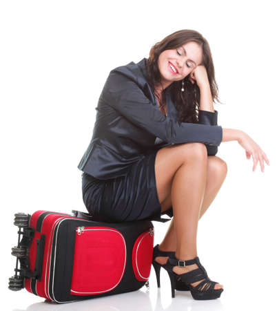 Full length of young business woman to late pulling red travel bag clock isolated on white background Stock Photo - 13187025