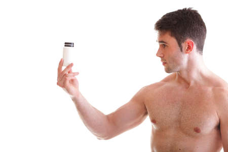 Athletic sexy male body builder holding a boxes with supplements on his biceps, man holding bottle of pills Stock Photo - 13187055