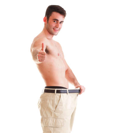 weight loss man: A muscular man showing how much weight he lost thumb up Stock Photo