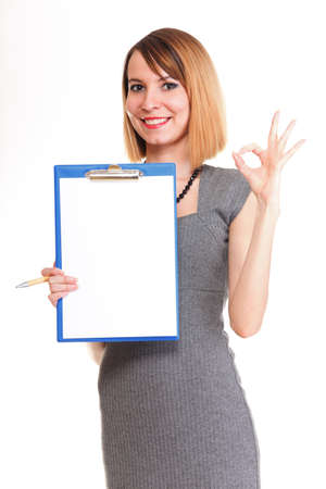 young business woman standing with her clipboard isolated on white background