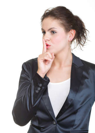 Young business woman gesturing silence sign, isolated on white background. photo