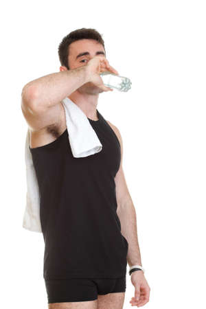 smiling young man holding towel and a bottle of water on an isolated background photo
