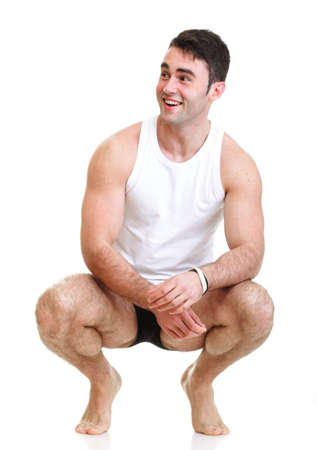 Healthy happy young man with towel isolated on white background photo