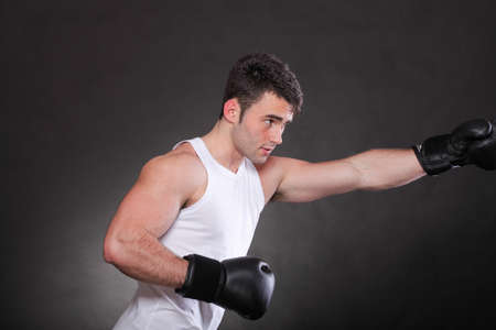 Boxer raising his arms strong athletic muscle man, sports guy showing his muscles male back isolated on black background Stock Photo - 13258546