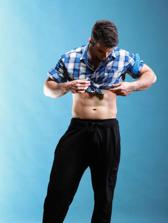 Stylish blue young adult hip hop male on blue background photo
