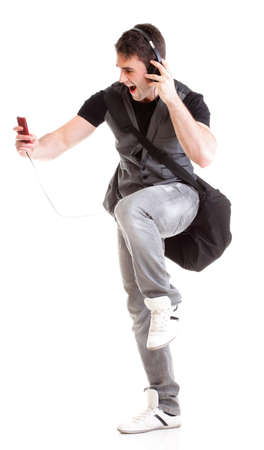 Full length portrait school boy phone isolated on white running while listening to music photo