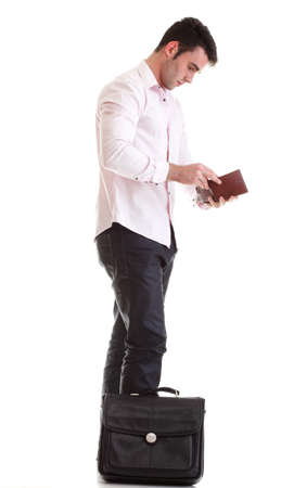 Business man looking at his empty wallet. Isolated on a white background photo