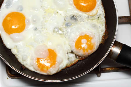 pan full of scramble eggs in a frying pan photo
