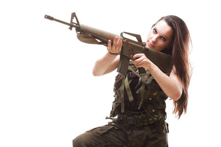Beautiful woman with rifle plastic Military Army girl Holding Gun white isolated background Stock Photo - 13258864