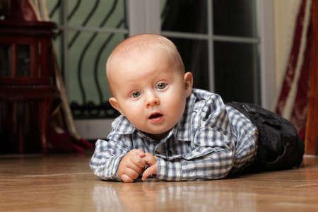 portrait of 6 months boy, male child sitting on floor Stock Photo - 13382513